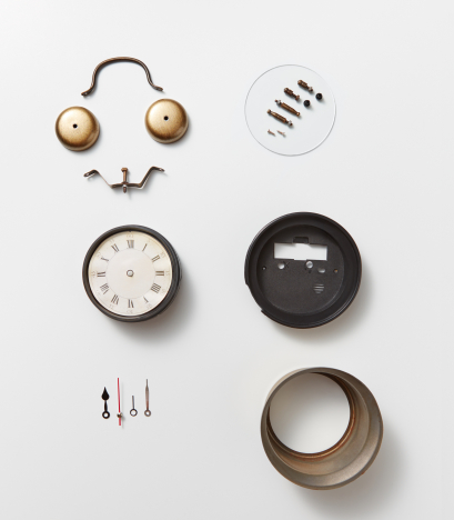 Details of old mechanical watches. Smiling face made of watch details on a gray background with copy space. Flat lay